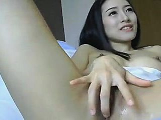 Asian Chick Toys her Pussy..